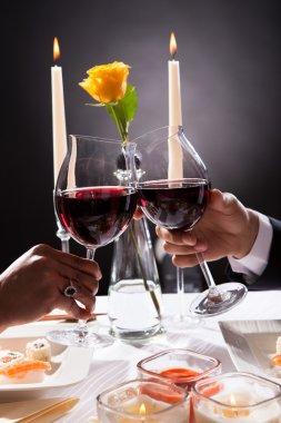 Couple Hands Toasting Wine