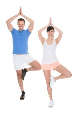 Portrait Of Couple Doing Yoga
