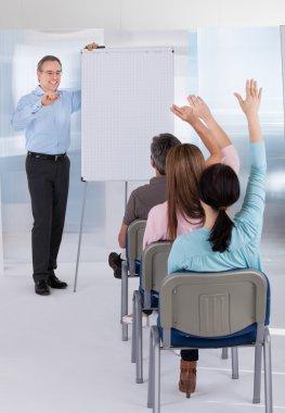 Mature Teacher Teaching Students