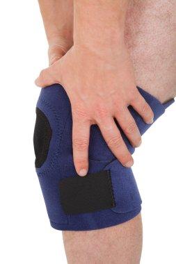 Close-up Of Man Wearing Knee Brace