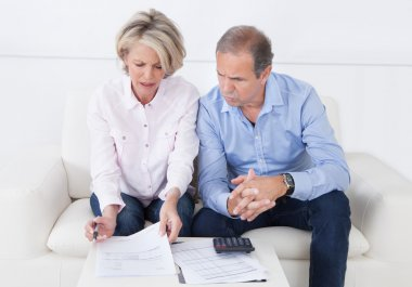 Couple doing family finances at home
