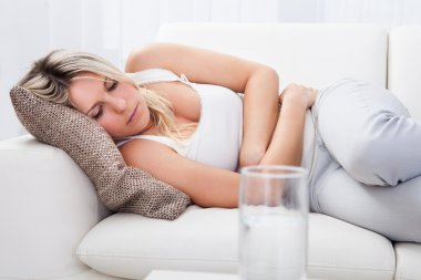 Woman with stomach ache