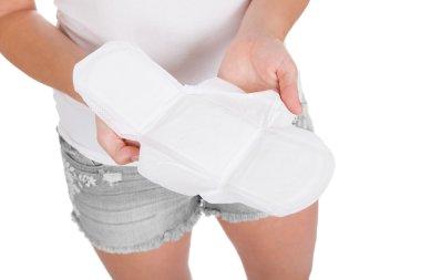 Woman holding Sanitary pad