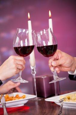 Close-up Of Couple Toasting Wine
