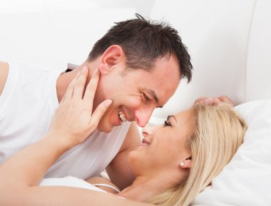 Couple On Bed Looking At Each other