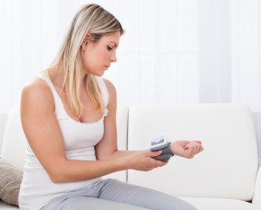 Woman measuring her blood pressure