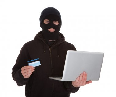 Burglar Holding Credit Card And Laptop