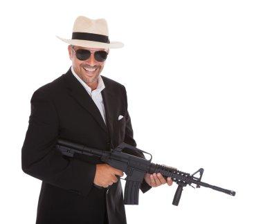 Mature Businessman Holding Gun