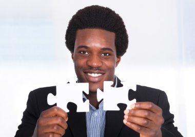 Businessman Holding Jigsaw Puzzle