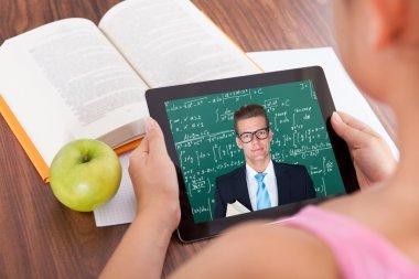Girl watching education tutorials