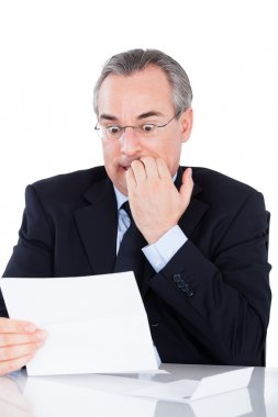 Portrait Of Shocked Mature Businessman Looking At Document stock vector