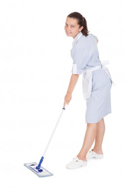 Young Maid Cleaning Floor With Mop