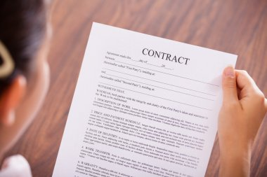 Businesswoman Looking At Contract Paper