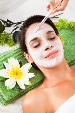 Beautiful Woman With Facial Mask At Spa