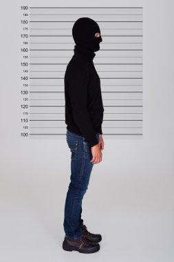 Burglar Standing Against Police Lineup