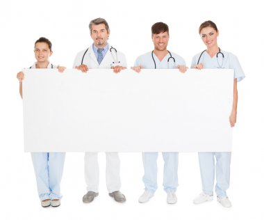 Doctors Holding Placard