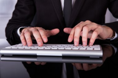 Businessman's Hand Typing On Keyboard