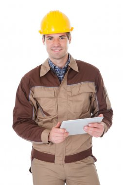 Construction Worker Holding Digital Tablet