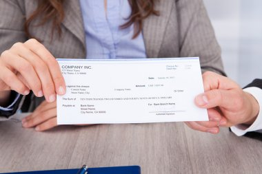 Businesspeople Holding Cheque