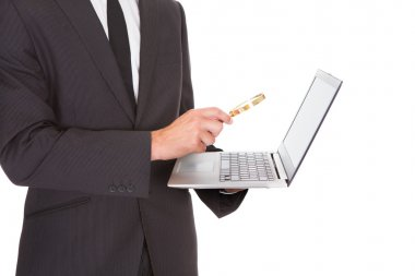 Man Holding Laptop And Magnifying Glass