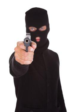 Burglar Holding Hand Gun
