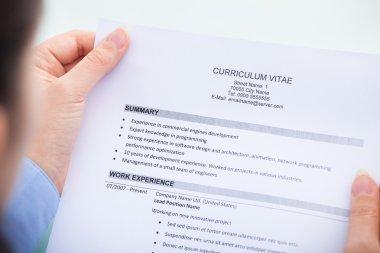 Businesswoman Reading Curriculum Vitae