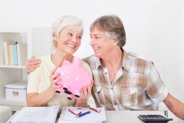 Senior Couple Saving Money