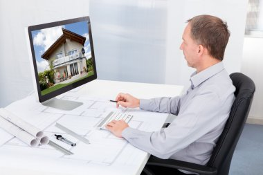Architect Working On Computer