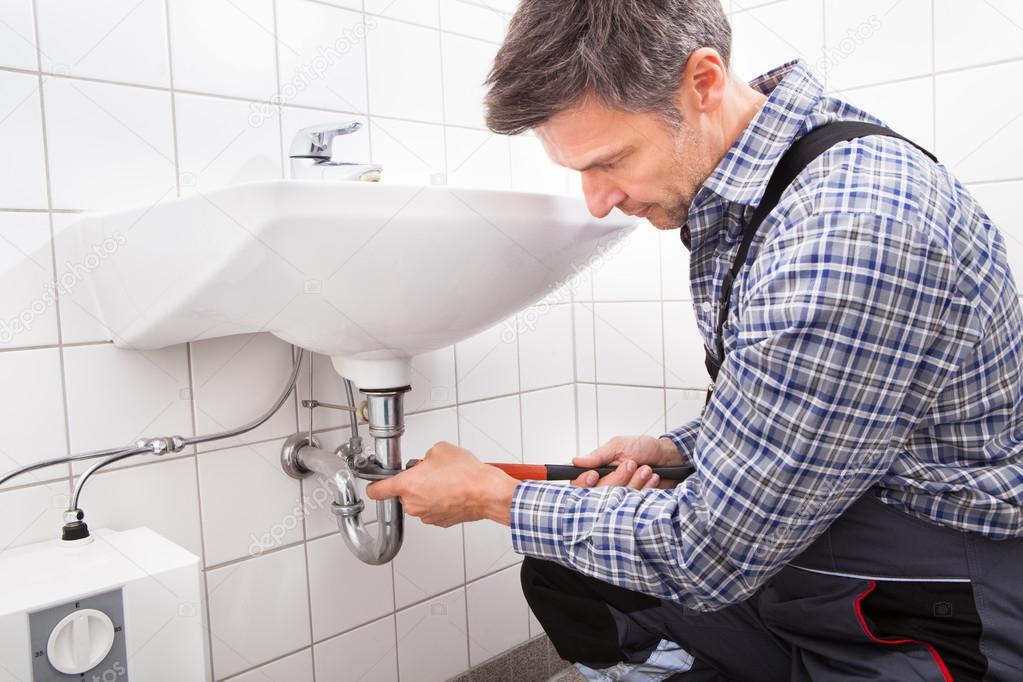 Plumber fitting sink pipe stock photo andreypopov for Plumber bathroom fittings