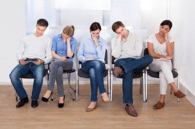 Group Of People Sleeping On Chair