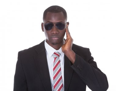 African Young Man With Hand On Ear
