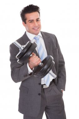 Businessman Lifting Dumbbells