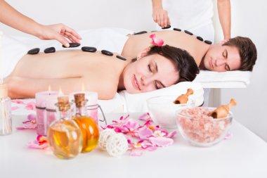Couple Having A Stone Massage