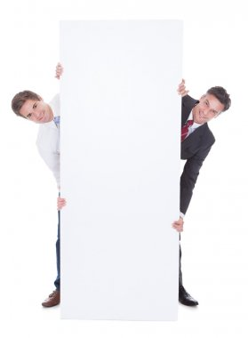 Two Businesspeople With Placard