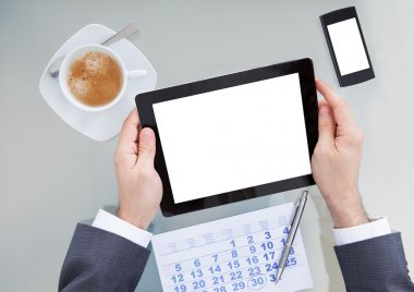 Businessperson With Digital Tablet And Calendar