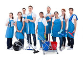 Photo Large diverse group of janitors with equipment