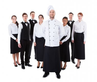 Chef standing in front of his team. Isolated on white stock vector