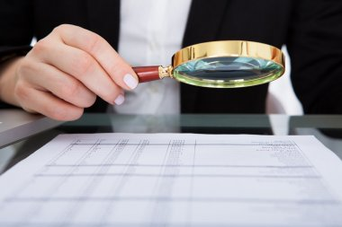 Businesswoman Holding Magnifying Glass
