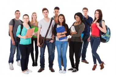 Confident University Students Walking Over White Background