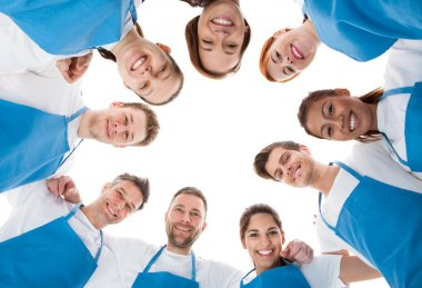 Cleaners standing in circle