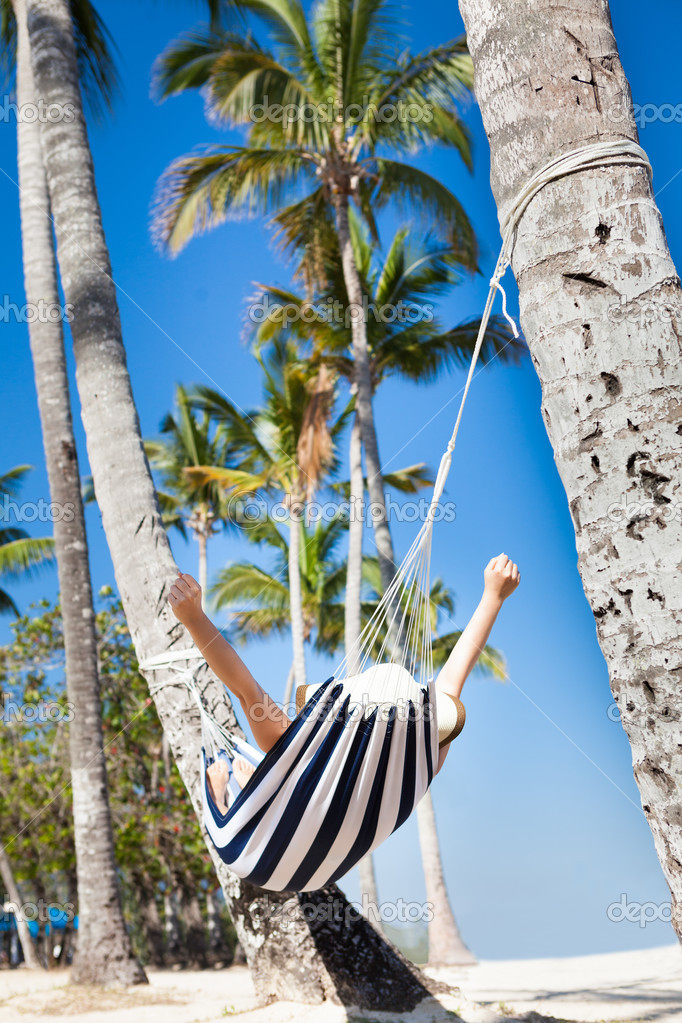 Woman Stretching In Hammock At Beach