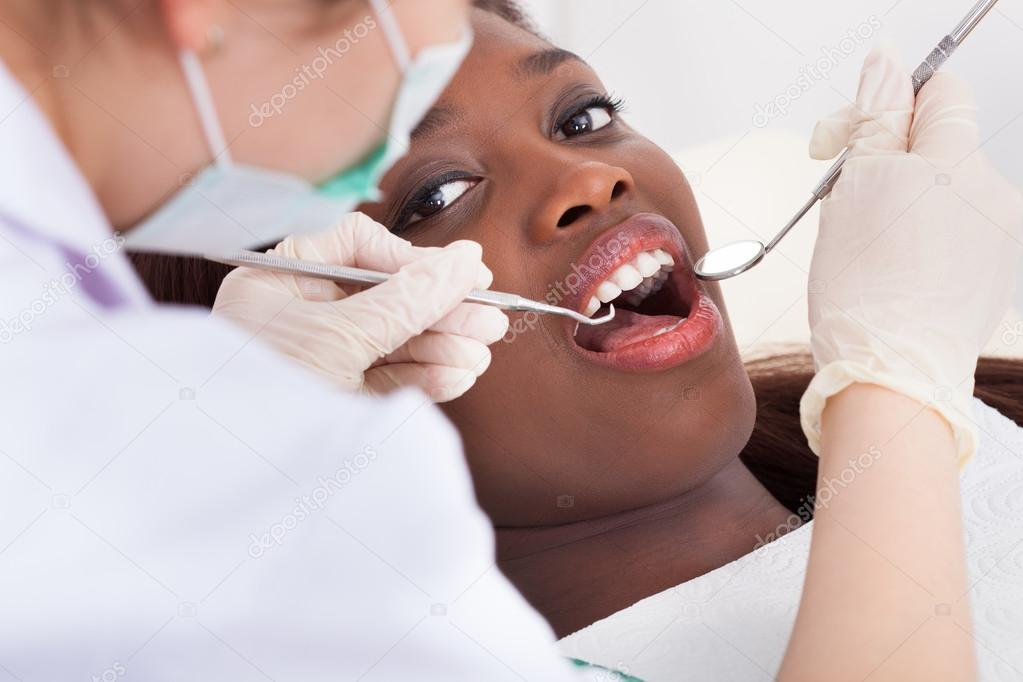 Patient Being Examined By Dentist