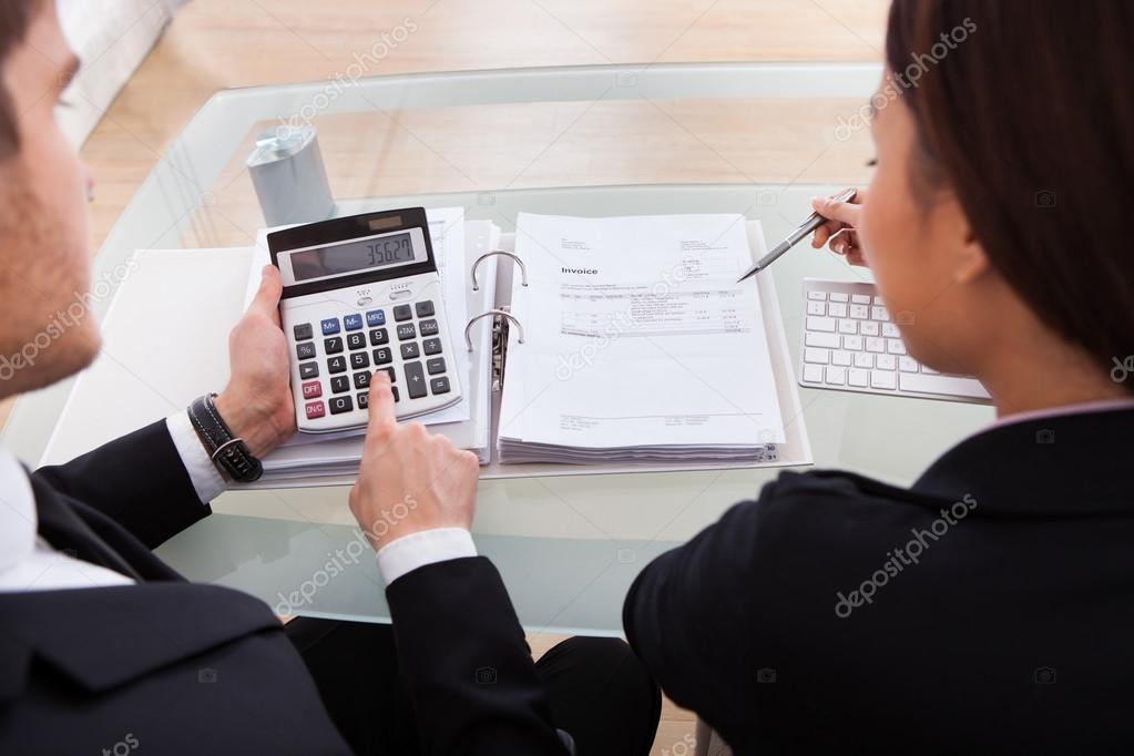 Business People Calculating Tax