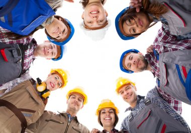 Construction workers standing in circle