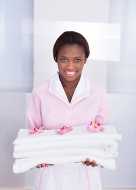 Housekeeper Carrying Towels In Hotel