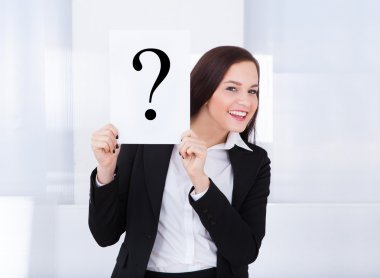 Happy Businesswoman Holding Question Mark Sign