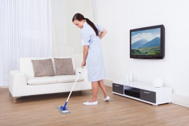 Maid Cleaning Floor With Mop