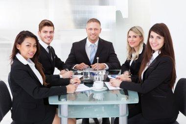 Confident Business Team At Desk