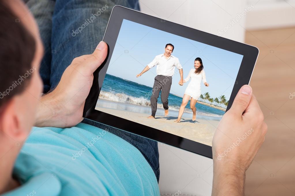 Man Watching Movie On Digital Tablet