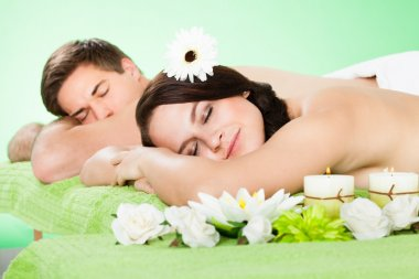 Couple Relaxing In Spa